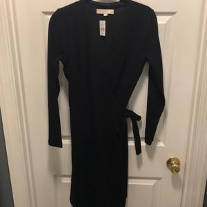 Black long sleeved tie waist dress